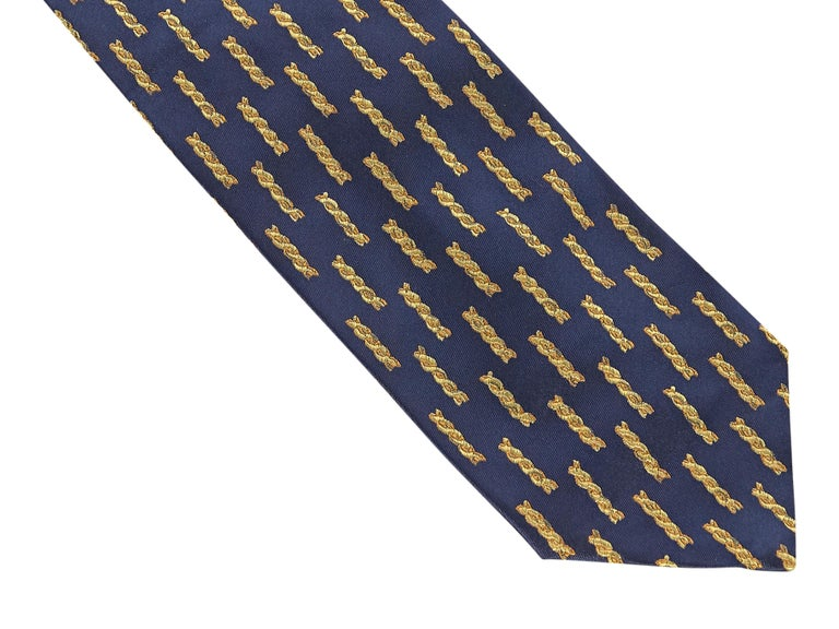 Product details:  Navy with gold chain-pattern silk tie by Gianni Versace. Self-tie. Wear as a belt around a cinched waist silk dress. 58.5