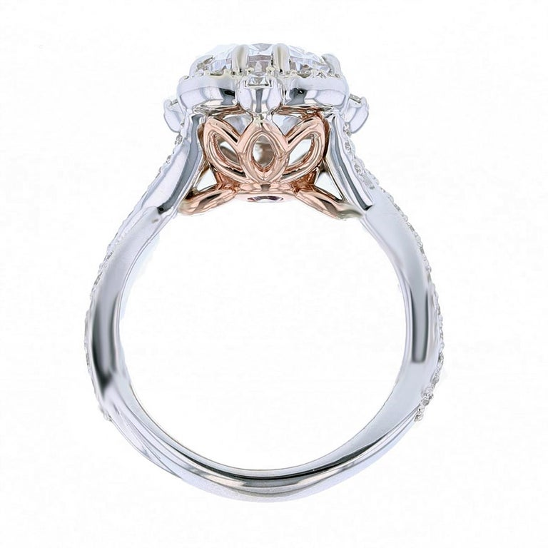 This ring is made in 14k white and rose gold and features a 2.02ct oval shape diamond color grade (G) clarity grade (VS1) Gia certified. The certificate number is