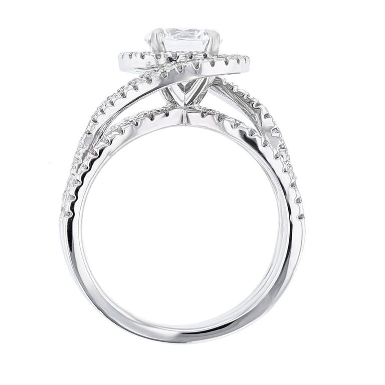 This ring is made in 14k white gold and features a 1.01ct round cut diamond GIA certified color grade (G) clarity grade (SI1). The certificate number is