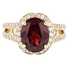 Nazarelle 18 Karat Yellow Gold 4.43 Carat Oval Garnet and Diamond Ring
