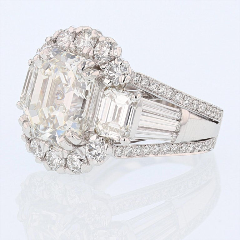 This ring is made in 18k white gold and features a 8.43ct GIA certified Emerald cut diamond color grade (J) clarity grade (VS1). The GIA certificate number is