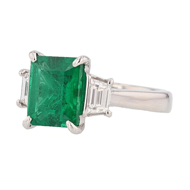 This ring is designed by Nazarelle and made in Platinum and features a 3.10ct Emerald Cut Natural Beryl Emerald (Treated) with a GIA certificate.  The GIA certificate number is