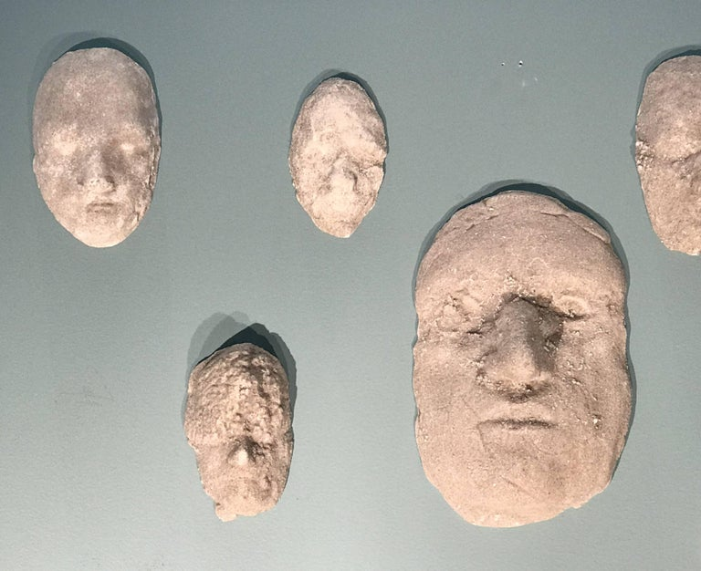"""A fine set of 12 plaster relief sculptures titled """"Heads"""" by American sculptor and artist Neal Beckerman (20th / 21st century). Beckerman was born in 1949 in Newton, Massachusetts. He attended the School of the Museum of Fine Arts, Boston,"""
