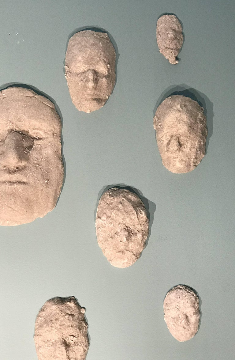 American Neal Beckerman Set of 12 Abstract Plaster Relief Sculptures, Heads For Sale