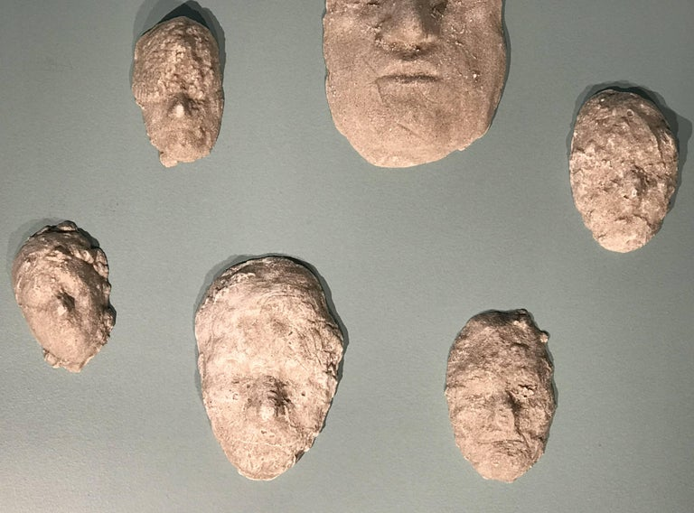 Molded Neal Beckerman Set of 12 Abstract Plaster Relief Sculptures, Heads For Sale