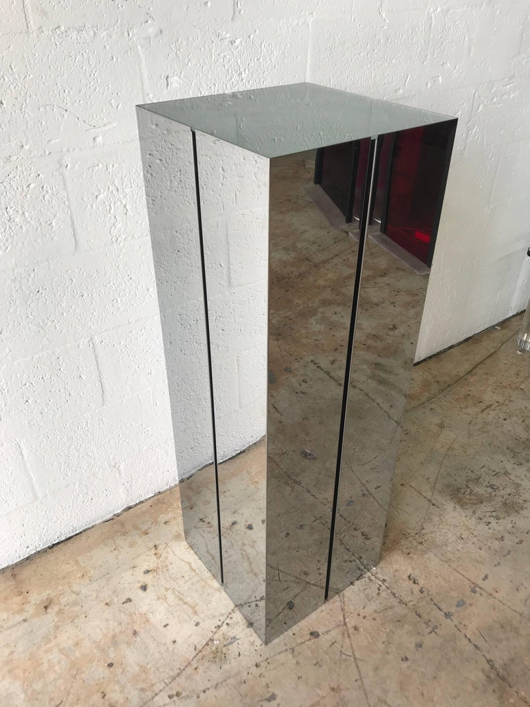 Illuminated pedestal stand or lamp, rendered in mirror polished stainless steel and frosted glass diffuser, designed by Neal Small for Kovacs.