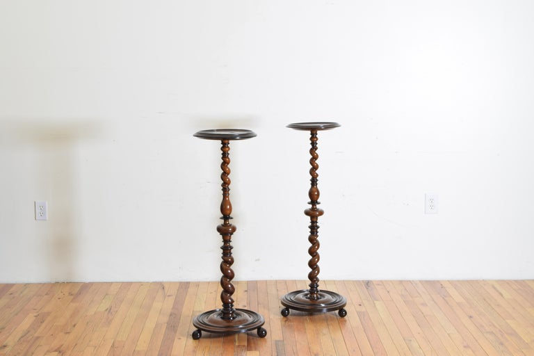 Very similar in size and construction and likely made by the same craftsman and time in Northern region of Lombardy, Italy. the pedestal tops are round with molded edges and raised on spiral turned supports, the bases are larger circular platforms