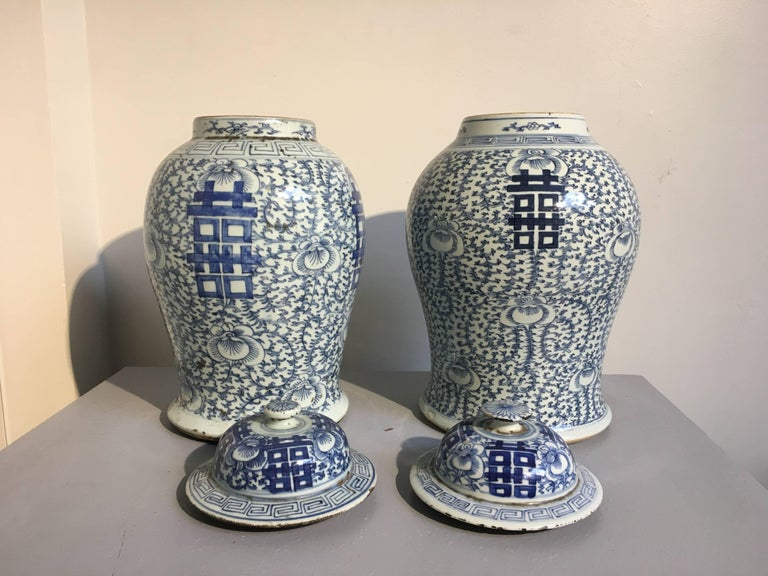 Qing Near Pair of Antique Chinese Blue and White Double Happiness Covered Jars For Sale