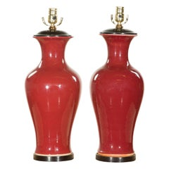 Near Pair of Chinese Contemporary Oxblood Vases Made into Table Lamps on Bases