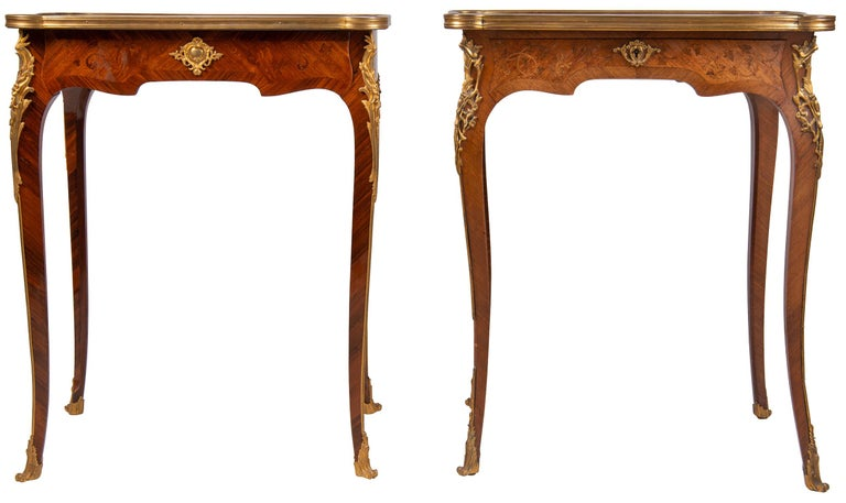 A very good quality near pair of French Louis XVI style side tables, in the manner of Francoise Linke. Each table having fine quality marquetry inlaid scrolling foliate decoration, a single frieze drawer and raised on elegant cabriole legs with