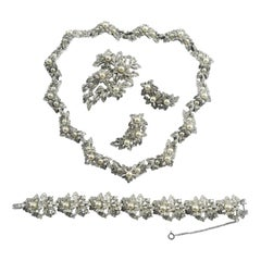 Necklace, earrings, bracelet and brooch, in paste and pearls, Jomaz, USA, 1950s.