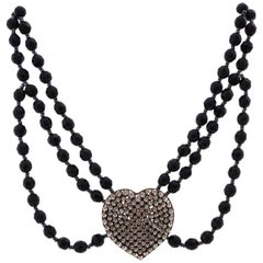 Necklace made of Gablonz glass beads with rhinestone heart