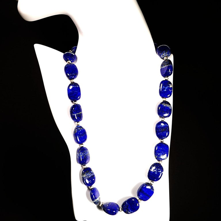 Custom made blue Lapis Lazuli nugget necklace enhanced with silver tone beads and a silver tone hook clasp. The lapis lazuli nuggets are 20x15x8mm and have a lovely polish. They are rounded rectangles. It's a pleasing 20 inches in length. This