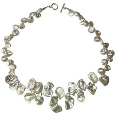 Necklace of White Iridescent Keshi Pearls with Sterling Silver Toggle