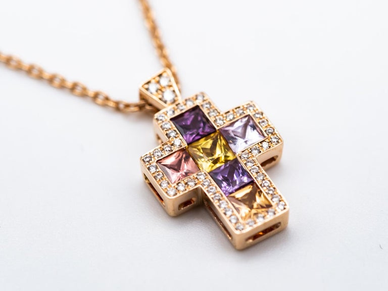 Necklace with Pendentif Multicolore Cross Saphirs Gold Rose.  Necklace decorated with a beautiful cross. princess sapphires 0.67 carats surrounded by 49 diamonds.0.090 carats the chain and the hanging are in 18 karat pink gold. the cross-shaped