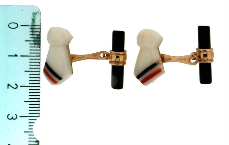 Elegant pair of cufflinks depicting a pair of Necktie features the combination of 18k Yellow gold and white agate, while the toggles are in onyx.  Cufflinks weight 8.60 grams