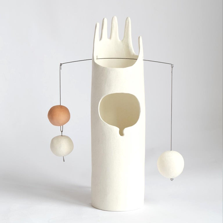 Rico's Cousin Neco is a contemporary hand-built sculptural ceramic table lamp that inspires the joy of working with hands through unpacking, assembling and balancing weights. The handmade ceramic globes and the hanging steel wire come fit right