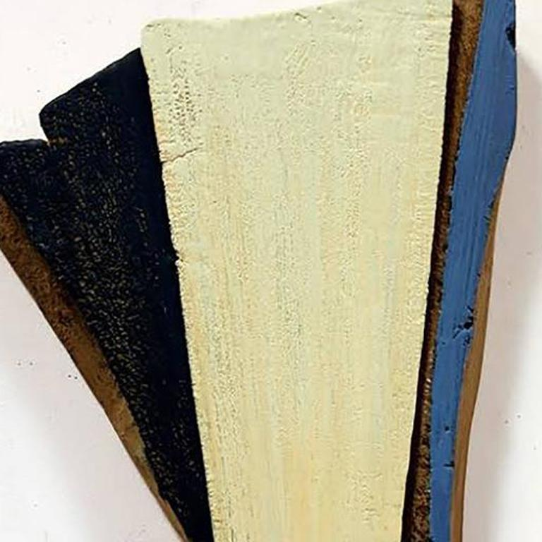 This contemporary, mixed media Wall Relief by Ned Evans features yellow, black and blue oil paint and resin on wood. Its modern design turns your guest or living space into a unique gallery wall.   NED EVANS is a California-based painter whose body