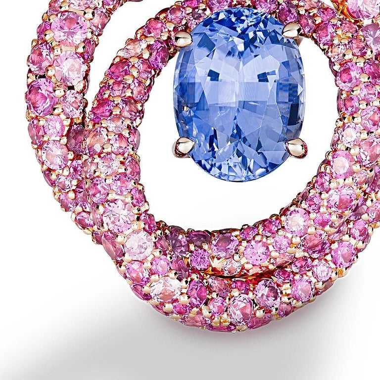 Irita Clip Earrings by Neha Dani feature a pair of Oval Violet Sapphire (no heat) of 4.39 Carat. Evoking the glow of nebulae, these are surrounded by 6.80 Carat Pink Sapphires, set in 18K Rose Gold.
