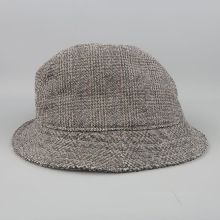 NEIL BARRETT fedora in dark gray glenplaid wool blend canvas with a small brim. Made in Italy.   Good Pre-Owned Condition. Marked: M   Measurements:   Opening: 7.5 x 7 in. Brim: 1.75 in. Height: 4 in.