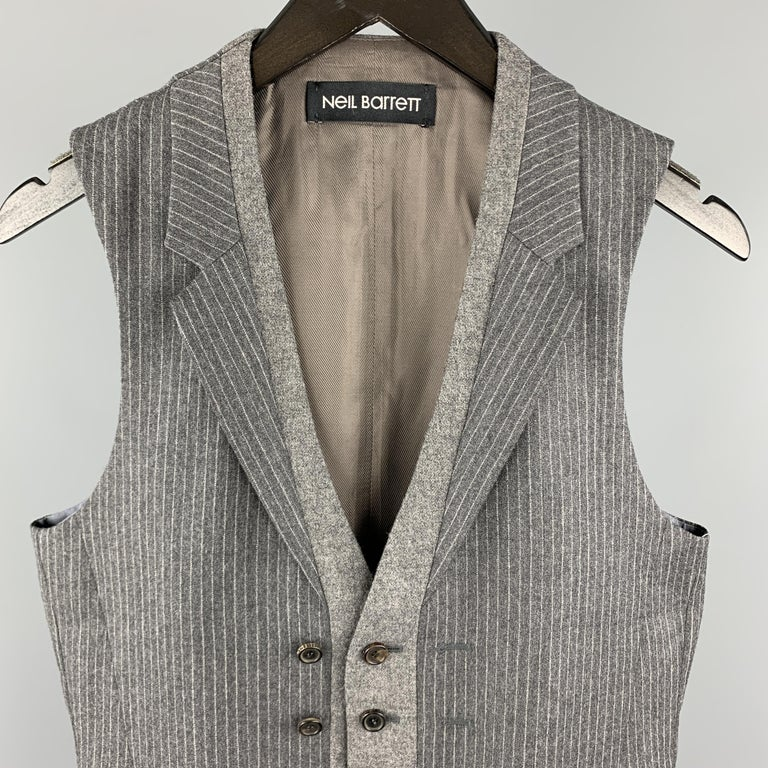NEIL BARRET vest comes in a gray stripe wool material, with a notch lapel, a solid grey trim, a double buttoned front, and slit pockets.   Excellent Pre-Owned Condition. Marked: S  Measurements:  Shoulder: 13 in.  Chest: 37 in.  Length: 26 in.