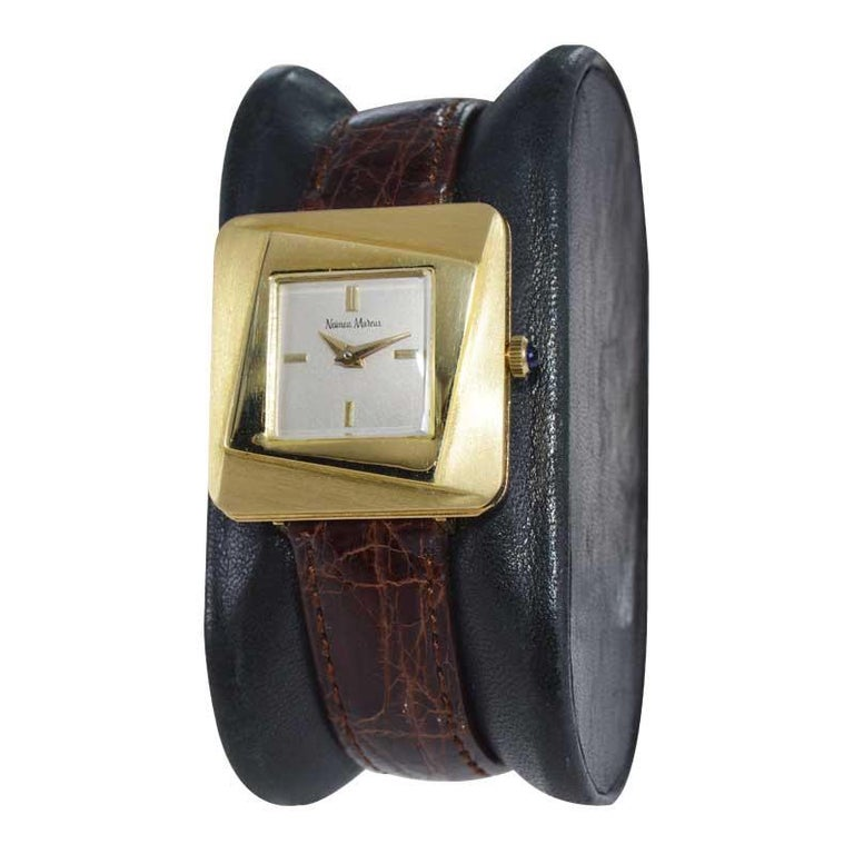 FACTORY / HOUSE: Neiman Marcus  STYLE / REFERENCE: Mid Century  METAL / MATERIAL: 18kt Yellow Gold CIRCA / YEAR: 1960's DIMENSIONS / SIZE: 28mm x 26mm MOVEMENT / CALIBER: Manual Winding / 17 Jewels  DIAL / HANDS: Original Silvered with Dauphine