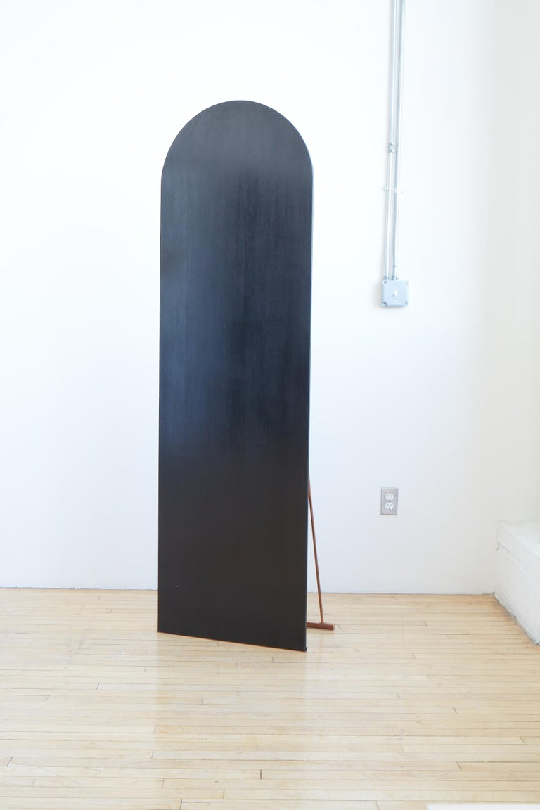 This sculpture by Nel Verbeke is part of her Embrace Melancholy series. The piece refers to 19th century practices of viewing the self through the prism of the black mirror in nature.