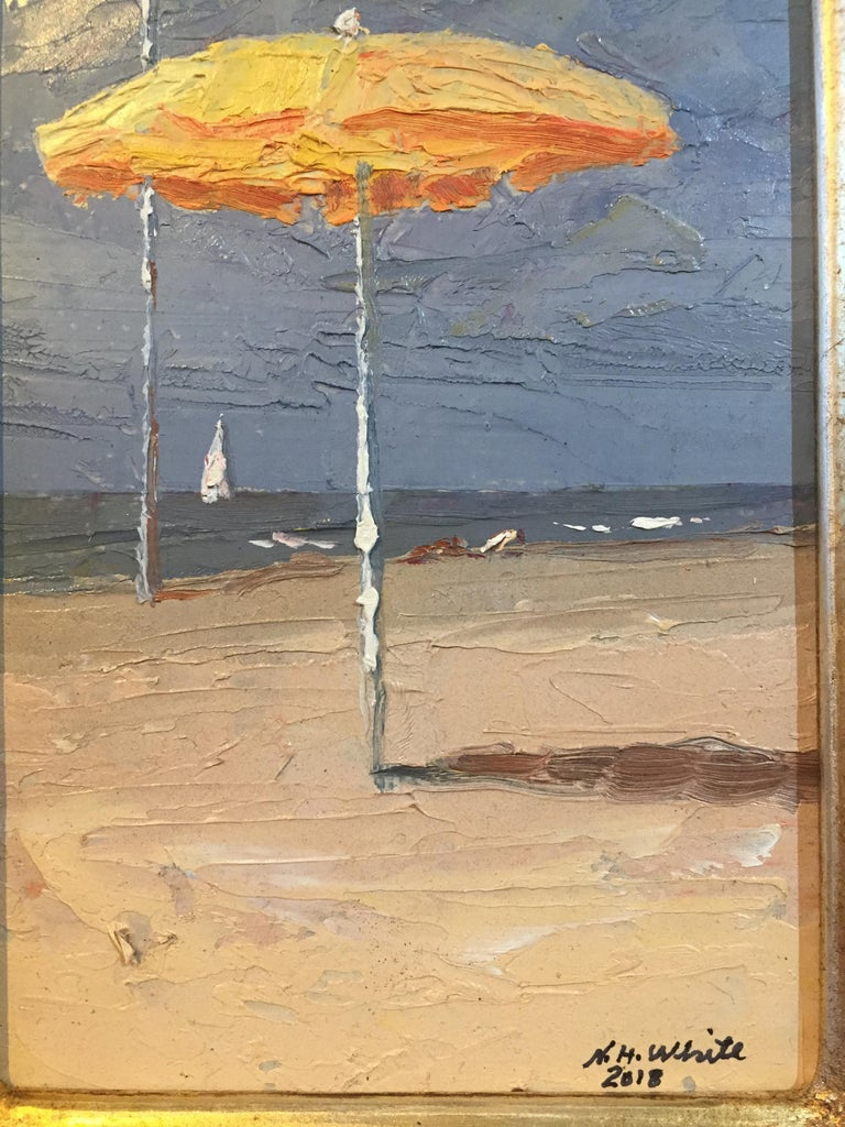 Painted by Nelson H. White, on site, in Italy in 2018. A single below umbrella stands centrally in a small 6 x 4 inch panel.  A small clip of a beach landscape. Painted thickly with a palette knife, creates grand texture.   Framed Dimensions are 12