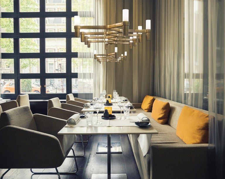 Family of pendant chandeliers, wall and floor lamps, with modular structure in die-casted aluminum and sandblasted glass diffusers. Structure in hand polished aluminum, glossy gold plated, black plated, or painted in matte white, matte black or