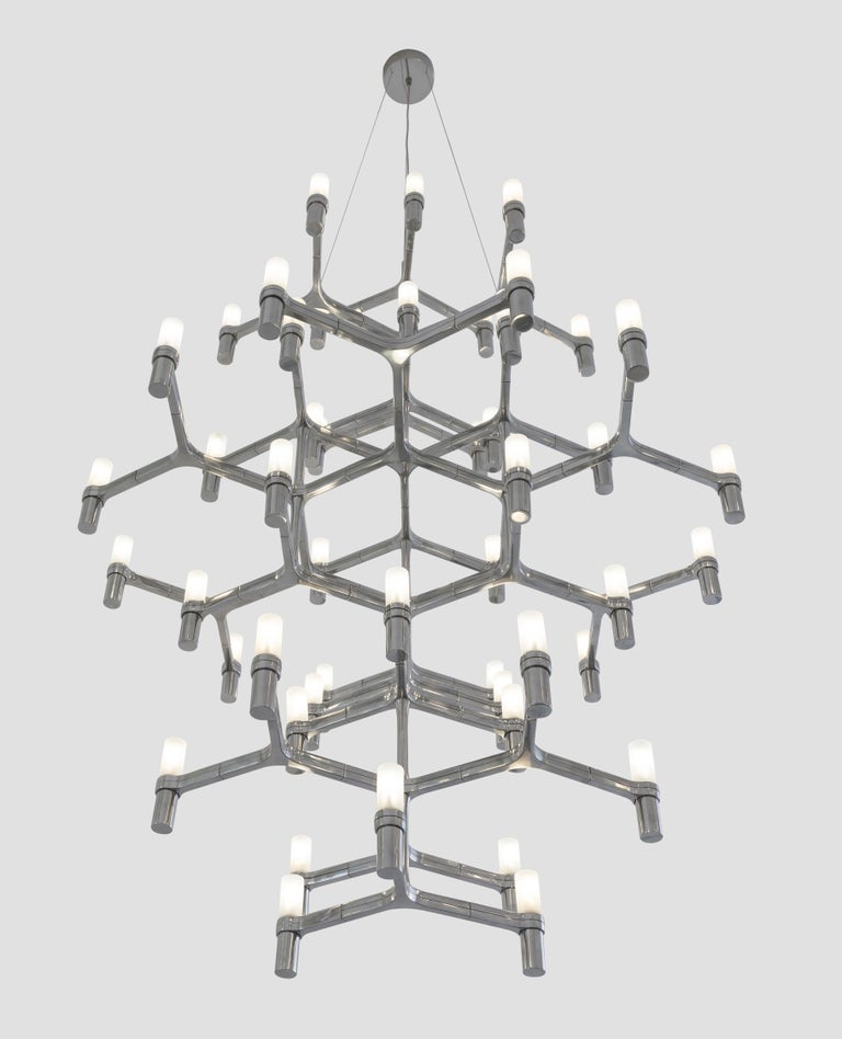 Family of pendant chandeliers, wall and floor lamps, with modular structure in die-casted aluminum and sandblasted glass diffusers. Structure in hand polished aluminum, glossy gold plated, black plated, or painted in matt white, matt black or gold.
