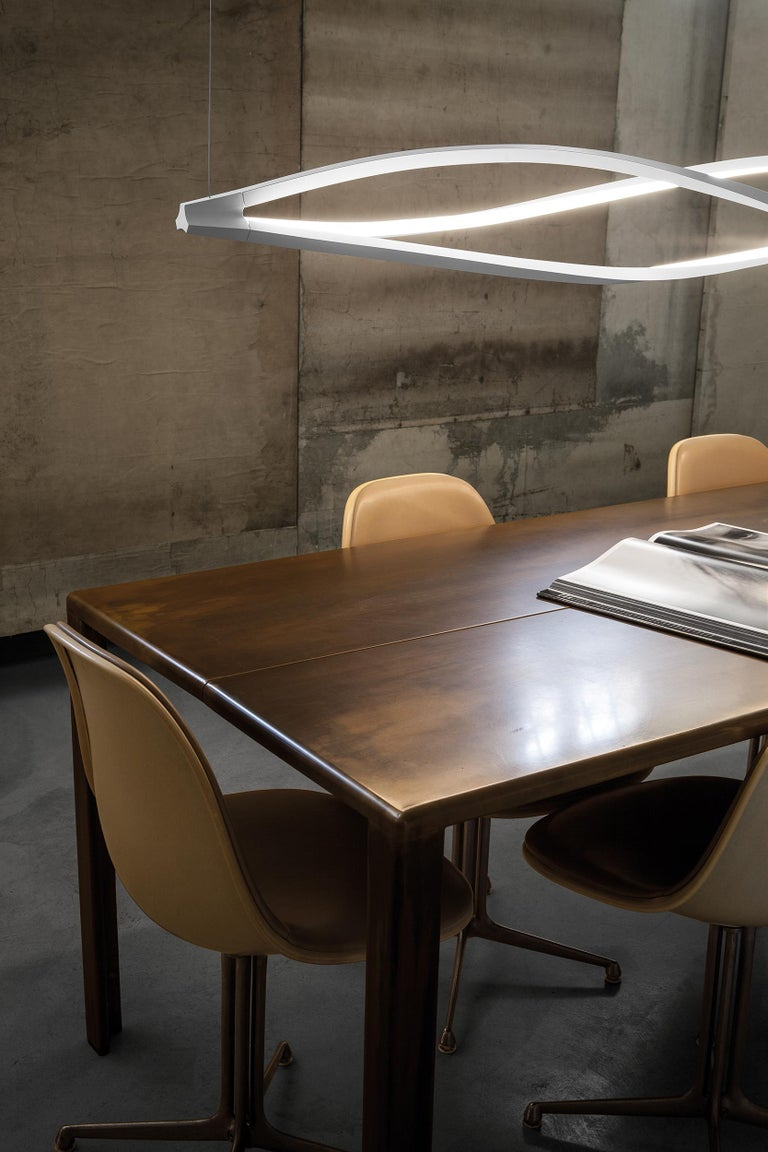 Floor and pendant lamps for warm and widespread LED lighting. The body is manufactured through a technology of torsion and misalignment of the extruded aluminum bar allowing for 360 degrees LED emission. This technology was extensively studied by