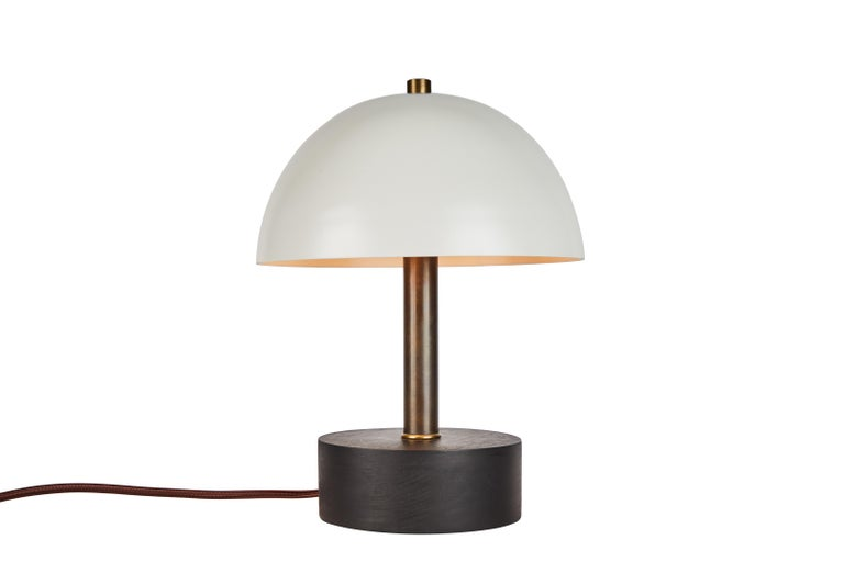 'Nena' table lamp in black metal and wood by Alvaro Benitez. Hand-fabricated by Los Angeles based designer and lighting professional Alvaro Benitez, these highly refined table lamps are reminiscent of the iconic midcentury Italian designs of