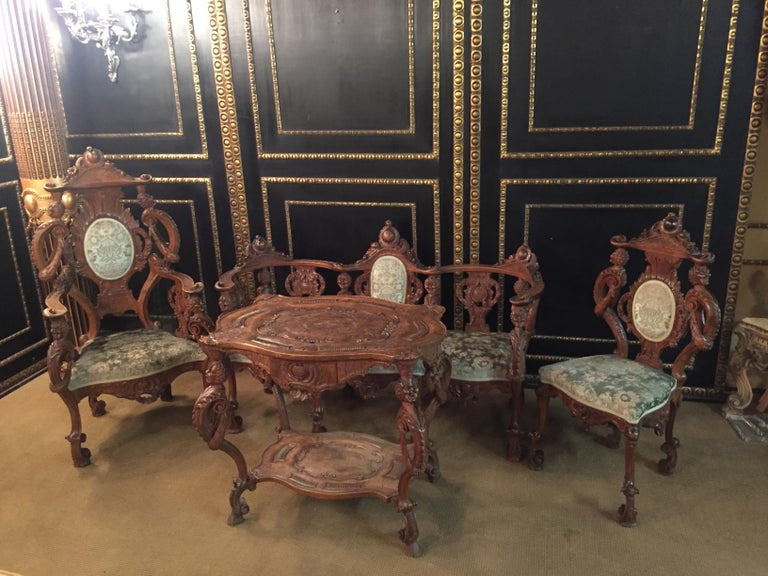 Here you have the opportunity to purchase a unique set. Fully carved with in solid walnut.  The set consists of a sofa, armchair, chair and table.