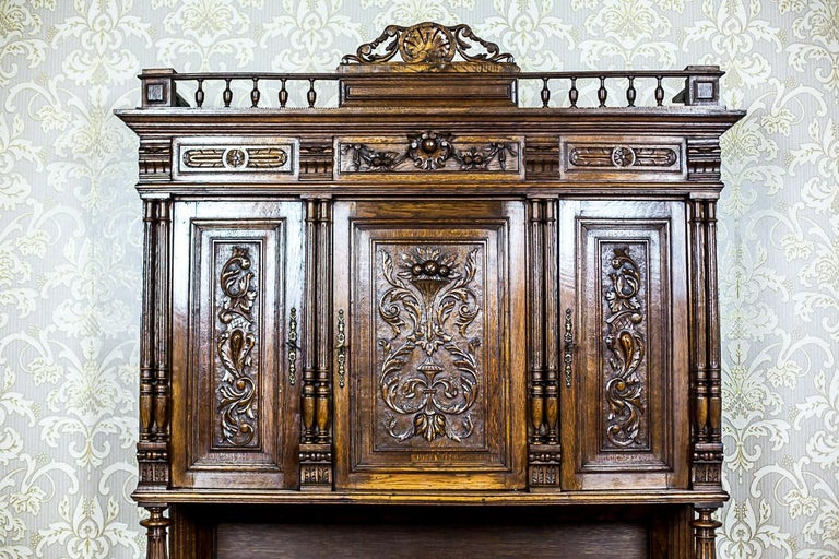 We present you this grand Neo-Renaissance piece of furniture made of solid oakwood, circa 1890. This cupboard is composed of a two-door base with a profiled socle, and a three-door upper section that is supported from the front with turned