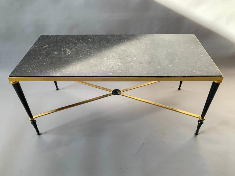 1940s neoclassical style, brass-plated coffee table with beautiful black marble top attributed to Jules Leleu. Great patination to brass