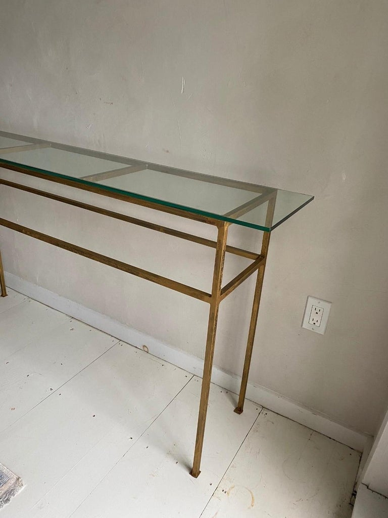 Elegant, contemporary and rustic at the same time with glass top and custom made iron base with a gold finish. Great as console or sofa table. Top and base can be sold separately by adding a top of your choice, be it glass, stone or wood. Base can