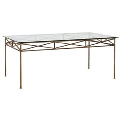 Neoclassical Inspired Metal Dining Table with Brass Accents and Glass Top