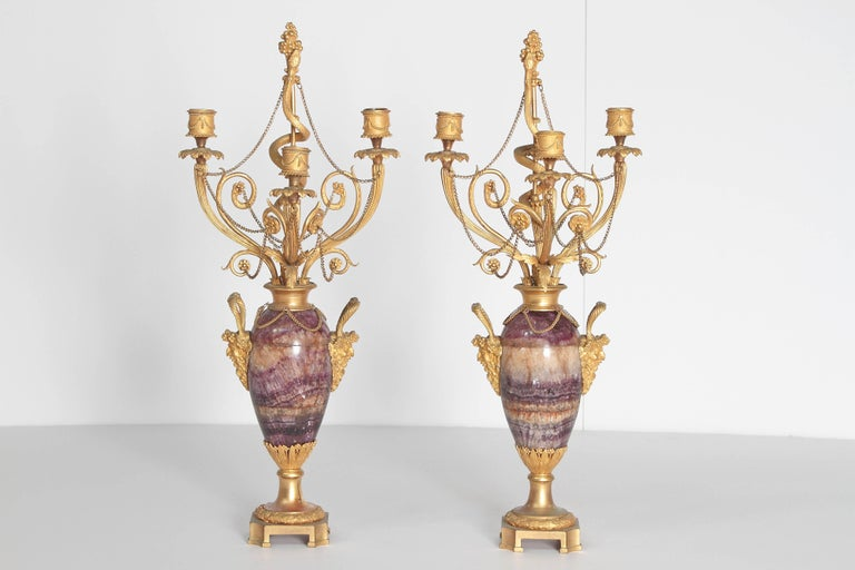 Neoclassical / Louis XVI-style gilt bronze mounted Blue John candelabra with Bacchus masks as handles each side, three (3) candleholders and center stem with serpent ascending, additional floral decorations and swags of gilt chain, 19th century