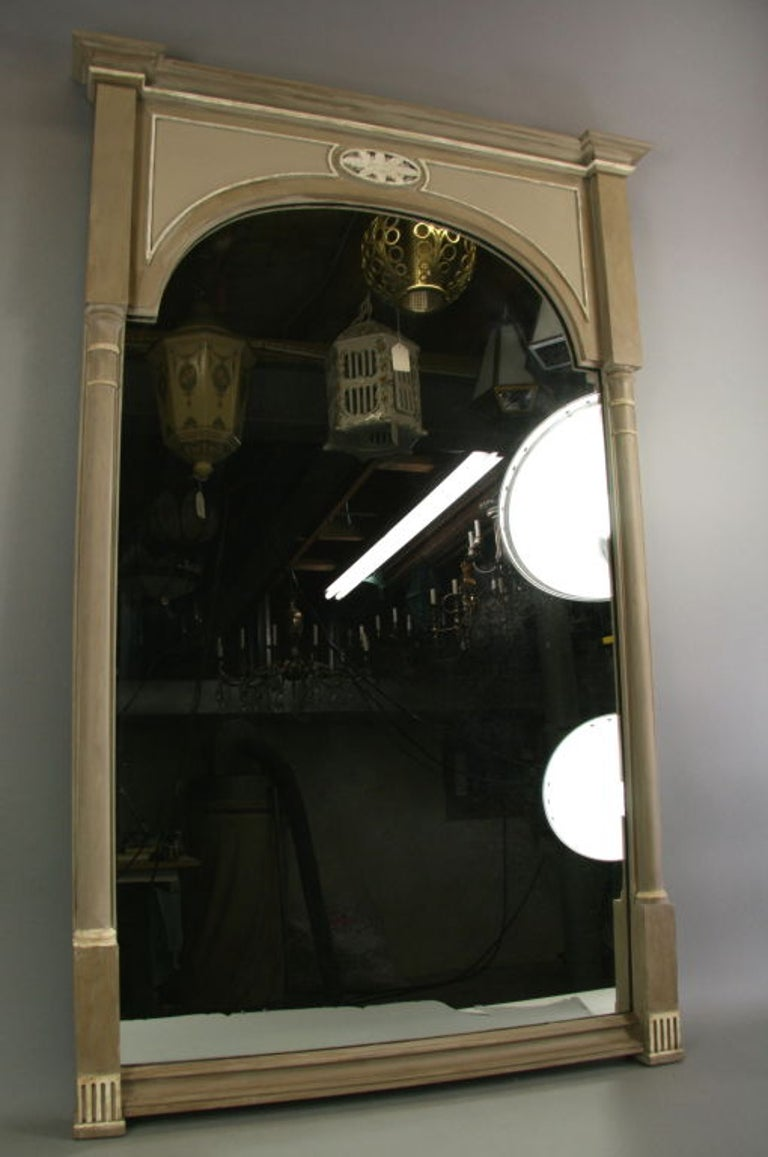 A neoclassical wood painted mirror in a coffee-white   color.