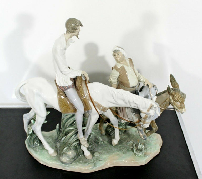 For your consideration is a gorgeous, porcelain table sculpture of Don Quixote and Sancho, signed Ruiz, stamped Lladro, handmade in Spain, circa 1970s. In excellent condition. The dimensions are 20
