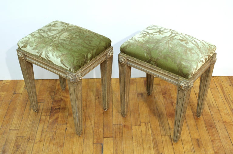 Pair of Neoclassical Revival style carved wood benches with upholstery. In great vintage condition with age-appropriate wear and use.