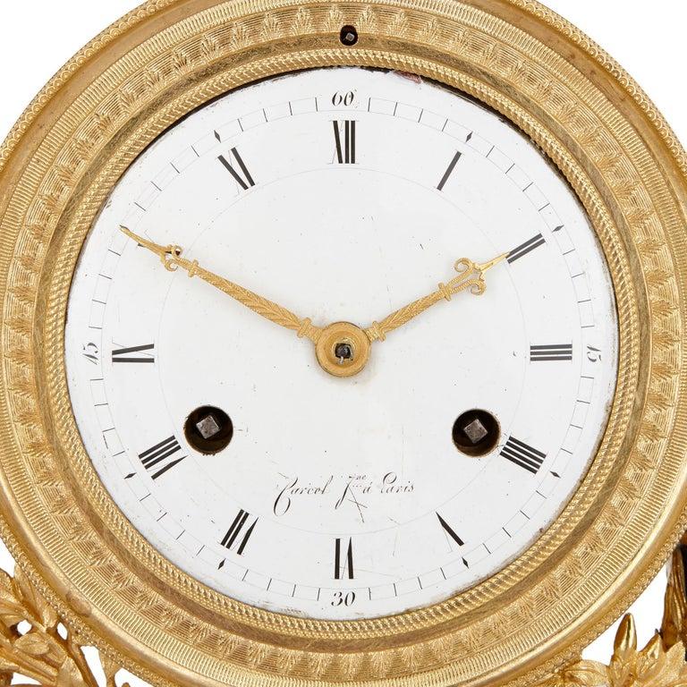 Louis XVI Neoclassical style antique lapis lazuli, jasperware and gilt bronze clock For Sale