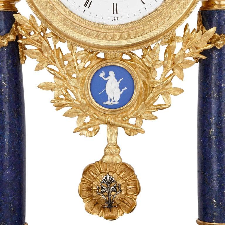 Veneer Neoclassical style antique lapis lazuli, jasperware and gilt bronze clock For Sale