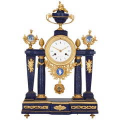 Neoclassical style antique lapis lazuli, jasperware and gilt bronze clock
