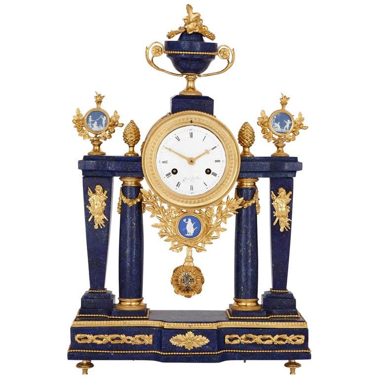 Neoclassical style antique lapis lazuli, jasperware and gilt bronze clock For Sale