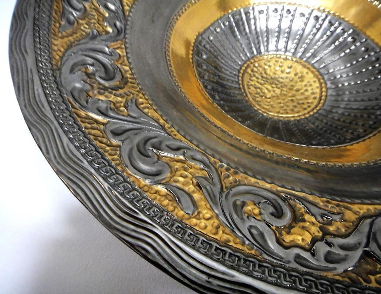 Marioni Neoclassical Style Ceramic Centerpiece, Italy  Offered for sale is a striking glazed ceramic centerpiece created in the neoclassical style by Marioni of Italy. The bowl is created to appear as though it is metal.
