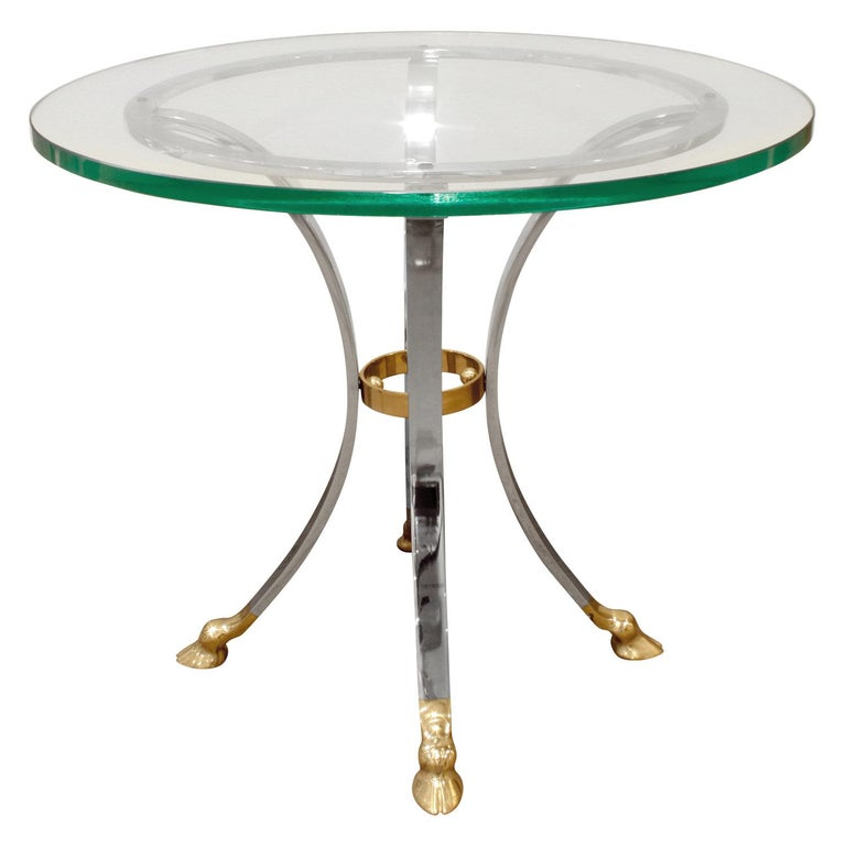 Neoclassical style end table with hoof motif in brass and steel with glass top, American, 1960s.