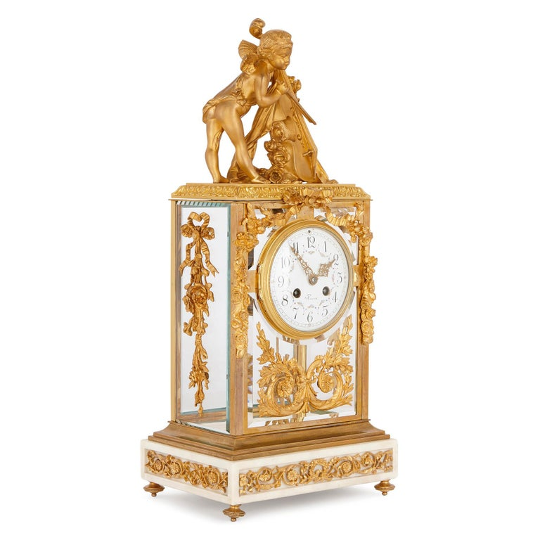 This French mantel clock is designed in an elegant Neoclassical style, after the decorative arts of the Louis XVI period (1754-1793). This clock will look beautiful placed on a mantelpiece, or in some other prominent position in a well-furnished