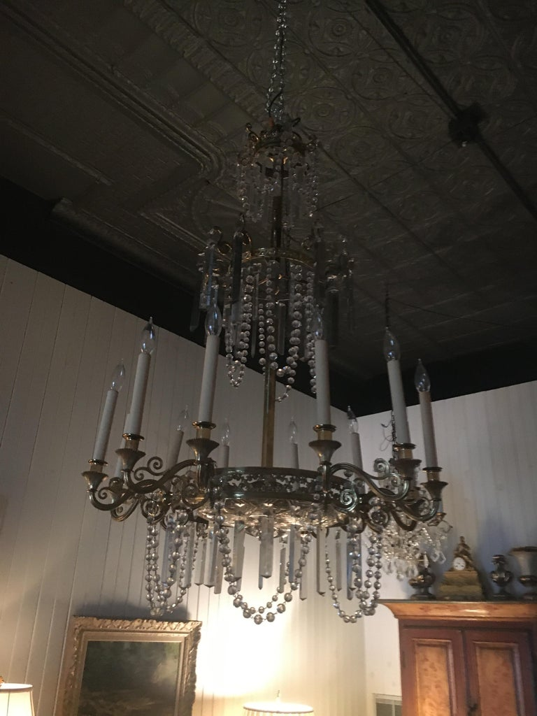 Regency Neoclassical Style Gilt Bronze Twelve-Light Crystal Chandelier.  Great scale. For Sale
