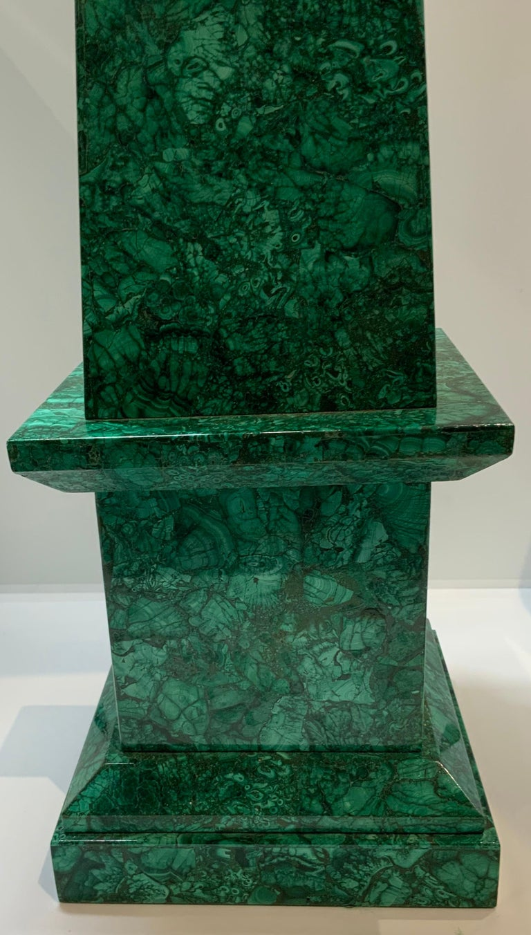 Imposing and solid malachite stone tower shaped as a square base with a long tapered rectangular body and ending with a pyramidal too.